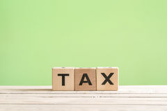Tax sign on a green background Royalty Free Stock Photography