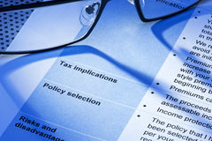 Tax Taxes Statement. A business form or statement about tax implications Royalty Free Stock Photo