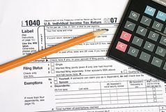 Tax Time 1. Tax form, pencil and calculator for tax time Stock Photo