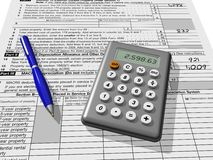 Tax Time. Figuring out taxes using a calculator Stock Image