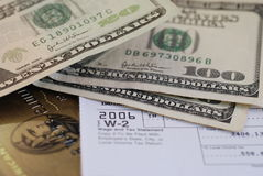 Tax Time. W-2, a credit card, and money stock photo