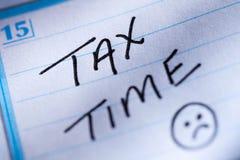 Tax time. Message written on a calendar Stock Photography