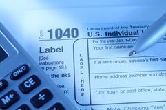 Tax time. Tax form with pen and calculator Royalty Free Stock Image