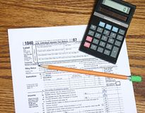 Tax Time 4. Tax form pencil and calculator for tax time Stock Photo