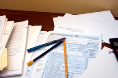 Tax Time. Forms, receipts and other papers are together to calculate and complete  income tax Stock Photo