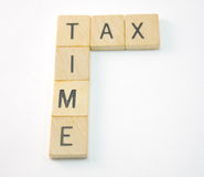 Tax Time. Spelled out in wooden tiles Stock Images