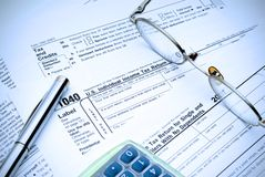 Tax Time again. Going through the maze of tax forms, electric blue tinit stock image