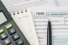 Tax time in April concept, pen on 1040 US individual income tax stock photography