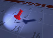 Tax time blues with red pushpin. Tax time reminder on April 15 using a pushpin or thumbtack toned in blue Stock Images