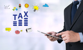 TAX TIME   Business team hands at work with financial reports Stock Images