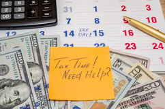 Tax Time! calendar with dollar and pen Royalty Free Stock Image