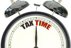 Tax time. Clock over a white background Royalty Free Stock Image