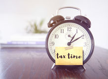 Tax time. Concept with alarm clock royalty free stock photography