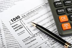 Tax Time. A Tax Form, Pen and Calculator Stock Image