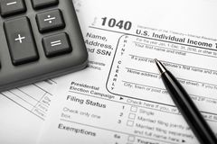 Tax Time. A Tax Form, Pen and Calculator Royalty Free Stock Images