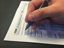 Tax Time III. Image of calculator, pencil, and IRS 1040 income tax form.image of individual completing 1040 IRS income tax return form royalty free stock photography