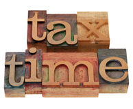 Tax time in letterpress type Royalty Free Stock Images