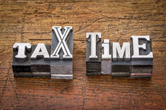Tax time in metal type Stock Photo