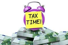 Tax time reminder clock Royalty Free Stock Photos