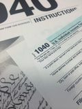 Tax Time VI. Image of instructions for the IRS income tax return form and 1040 IRS income tax return form Stock Image