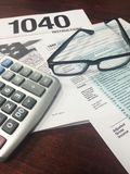 Tax Time VI. Image of instructions for the IRS income tax return form and 1040 IRS income tax return form Stock Photos