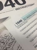 Tax Time VII. Image of instructions for the IRS income tax return form and 1040 IRS income tax return form stock photo