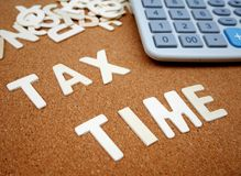 `Tax time` writing with wooden letter Royalty Free Stock Photos