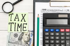 Free Tax Time Written On Sticker With Tax Form, Calculator And Money On Office Table. Top View. Business Concept Royalty Free Stock Photo - 207701195