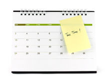 Tax Time written on yellow paper note taped on calendar page isolated on white background Stock Photography