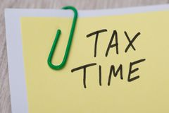 Tax time written on yellow note Royalty Free Stock Images