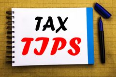 Tax Tips. Business concept for Taxpayer Assistance Refund Reimbursement Written on notepad note paper background with space office. Tax Tips. Business concept Royalty Free Stock Photo