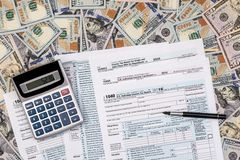 1040 tax from with us dollar banknote, pen. And calculator stock images