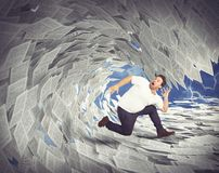 Tax wave. Man runs away from wave of sheets Stock Photography