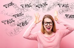 Tax with woman feeling stressed. Tax with young woman feeling stressed on a pink background Stock Image