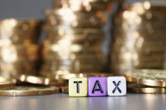 Tax word on dices Stock Photography
