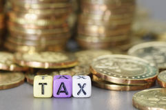 Tax word on dices Stock Images
