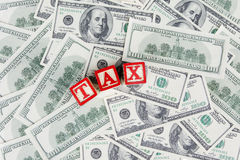 TAX word with dollar currency Stock Photography