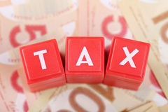 Tax word on money Stock Photography