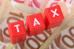Tax word with money Stock Photo