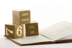 Tax Year Ledger. Date blocks showing the start of the tax year 2009 with a financial ledger Stock Photo