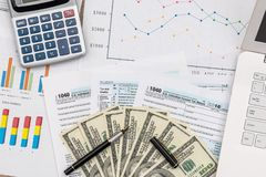 Taxation concept, business graphs with dollar. Banknotes and laptop stock photos