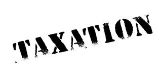 Taxation rubber stamp. Grunge design with dust scratches. Effects can be easily removed for a clean, crisp look. Color is easily changed Stock Images