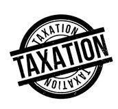 Taxation rubber stamp. Grunge design with dust scratches. Effects can be easily removed for a clean, crisp look. Color is easily changed Royalty Free Stock Photography