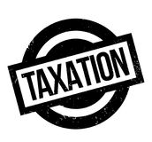 Taxation rubber stamp. Grunge design with dust scratches. Effects can be easily removed for a clean, crisp look. Color is easily changed Royalty Free Stock Images