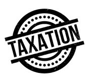 Taxation rubber stamp. Grunge design with dust scratches. Effects can be easily removed for a clean, crisp look. Color is easily changed Stock Image