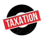 Taxation rubber stamp Stock Photos