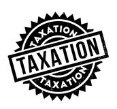 Taxation rubber stamp. Grunge design with dust scratches. Effects can be easily removed for a clean, crisp look. Color is easily changed Royalty Free Stock Photo