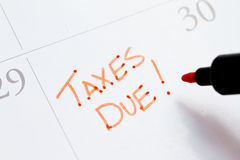 Taxes. Due written on calendar with red pen