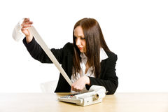 Taxes. Conceptual photo of woman with calculator calculating her taxes Royalty Free Stock Photography