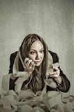 Taxes. Conceptual photo of woman with calculator calculating her taxes Royalty Free Stock Images